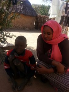 IAS_staff_Sally_visiting_children_with_disabilities