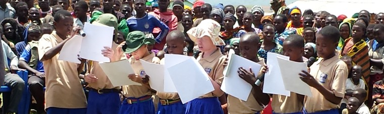 Children performed to create awareness for people with disabilities in Mawenzusi, Tanzania.